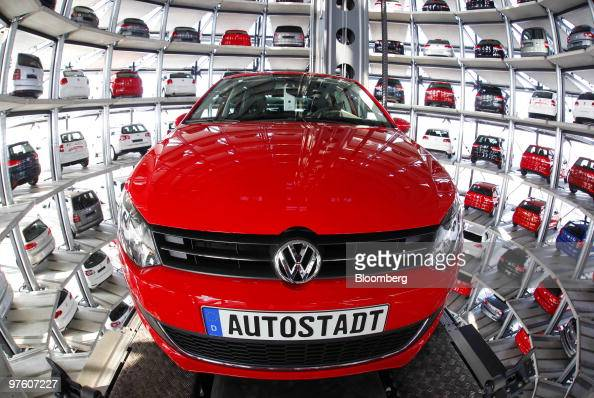 A Volkswagen Golf VI automobile is loaded into the Autotuerme or Car Towers at the Autostadt car dealership in Wolfsburg Germany on Wednesday March...