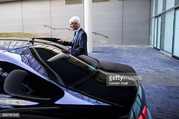 Volkswagen Group Chairman Matthias Mueller goes to his car after a press conference to announce the latest update in the company's handling of the...