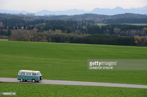Volkswagen Kombi owner Wanja Fuhrmann drives his Volkswagen T2 camper van built in the year 1975 on a road near Landsberg southern Germany on...