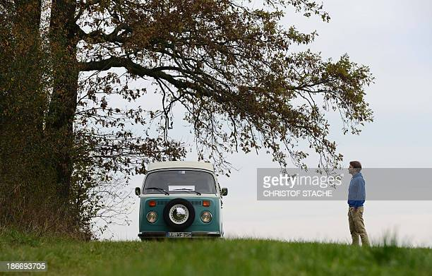 Volkswagen Kombi owner Wanja Fuhrmann poses in front of his Volkswagen T2 camper van built in the year 1975 near Landsberg southern Germany on...