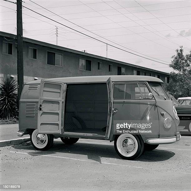 Volkswagen Kombi Panel Van Front 3/4 view of passenger side shows barn doortype access to rear compartment from sidewalk side of bus Austere front...