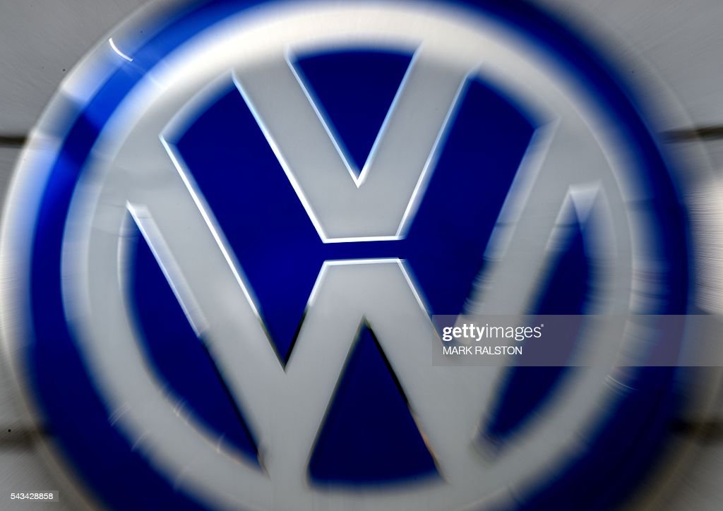 Volkswagen logos at a dealership in Los Angeles, California on June 28, 2016. Volkswagen has agreed to pay out $14.7 billion in a settlement with US authorities and car owners over its emissions-cheating diesel-powered cars. The settlement filed in federal court calls for the German auto giant to either buy back or fix the cars that tricked pollution tests, and to pay each owner up to $10,000 in cash. / AFP / Mark Ralston