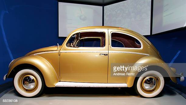 Volkswagen show the one millionth VW Beetle formerly known as the Kaefer in a gold plated with gemstones in the Autostadt Museumon July 14 2005 in...