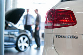 A Volkswagen Touareg automobile sits on display in the used car sales area inside the Volkswagen AG showroom in Berlin Germany on Thursday Aug 6 2015...
