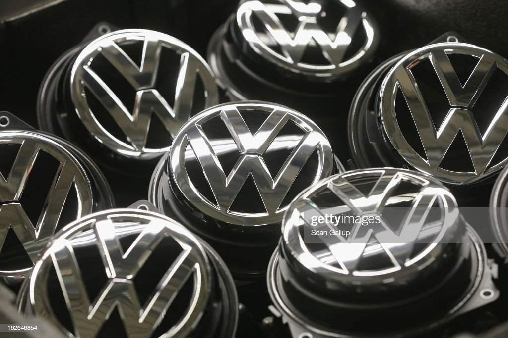 Volkswagen trunk ornaments bearing the VW logo lie next to the Golf VII assemly line at the Volkswagen factory on February 25, 2013 in Wolfsburg, Germany. Volkswagen will announce financial results for 2012 on March 14.