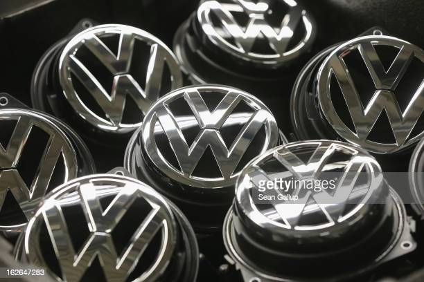 Volkswagen trunk ornaments bearing the VW logo lie next to the Golf VII assembly line at the Volkswagen factory on February 25 2013 in Wolfsburg...