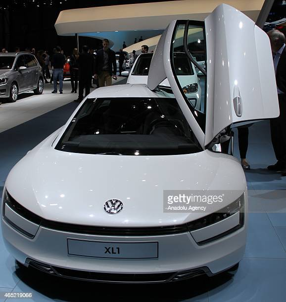 Volkswagen XL1 automobile produced by Volkswagen AG stands on display at the company's stand during the press day of the 85th Geneva International...
