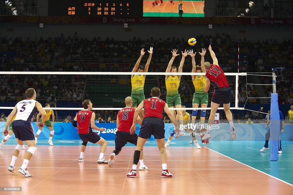 USA Clayton Stanley (13) in action vs Brazil Dante Amaral (18), Gustavo Endres (13) and Murilo Endres (8) during Men's Gold Medal Match at Capital Gymnasium. Beijing, China 8/24/2008