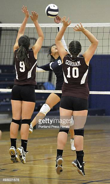 Volleyball game between Yarmouth and Gorham girls played at Yarmouth on September 12 2012 Gorham defenders Lauren Carter and Lexi Merrifield look to...