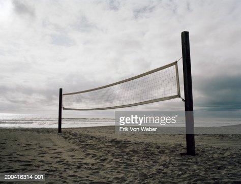 Volleyball net set up on beach : Stock Photo