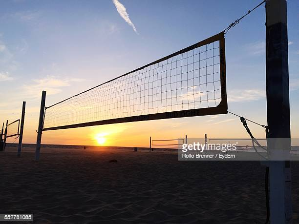 Volleyball Nets On Beach Against Sky At Sunset