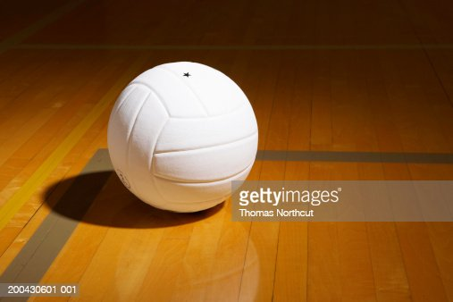Volleyball On Indoor Volleyball Court Elevated View Stock