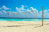 Empty beach volleyball net against a idyllic seascape