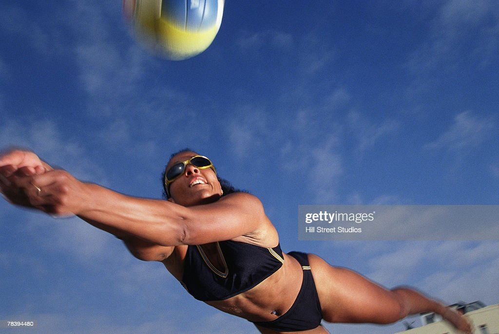 Volleyball player diving for the ball