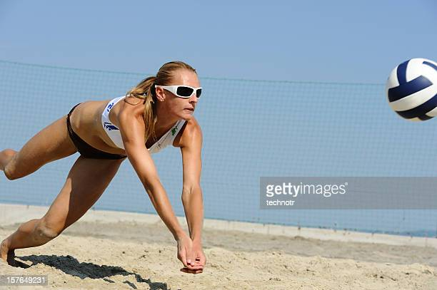 Volleyball player saving the ball in attractive way