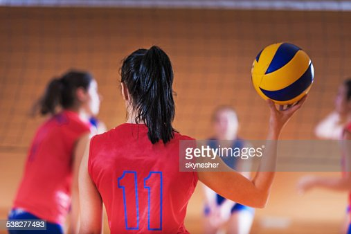 Volleyball player with a ball.