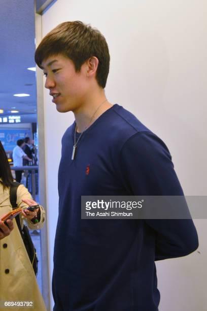 Volleyball player Yuki Ishikawa speaks to media reporters on arrival at Narita International Airport on April 16 2017 in Narita Chiba Japan