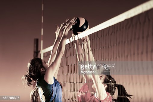 Volleyball players in action.