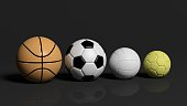 Different balls of various games on black background