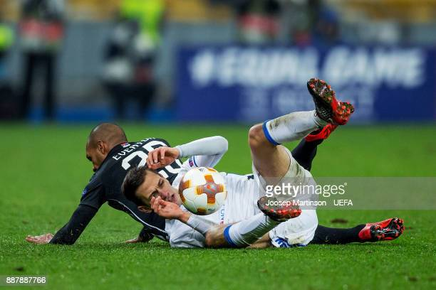 Volodymyr Shepelev of FC Dynamo Kyiv is tackles by Everton Bilher of FK Partizan Belgradeduring the UEFA Europa League group B match between FC...