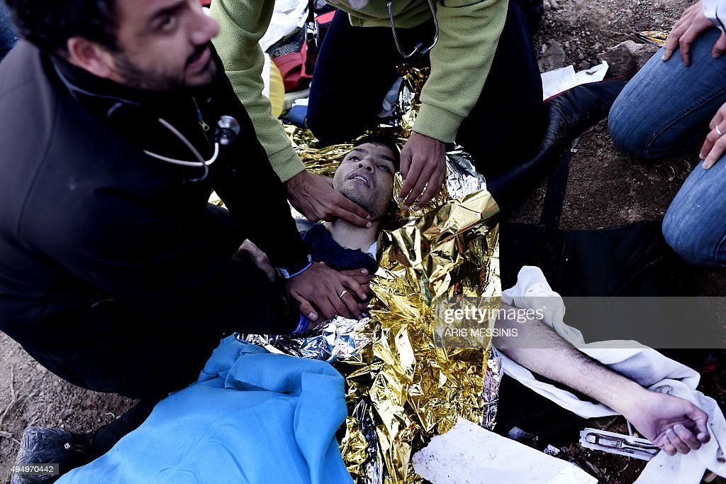 A volonteer doctor and paramedics try to revive a man on the Greek island of Lesbos on October 30 after a boat with refugees and migrants sank while...