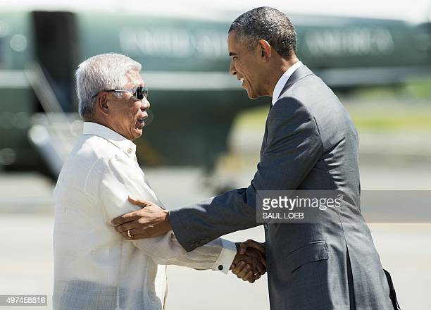 Voltaire Gazmin Minister of National Defense of the Philippines greets US President Barack Obama following his arrival at the international airport...