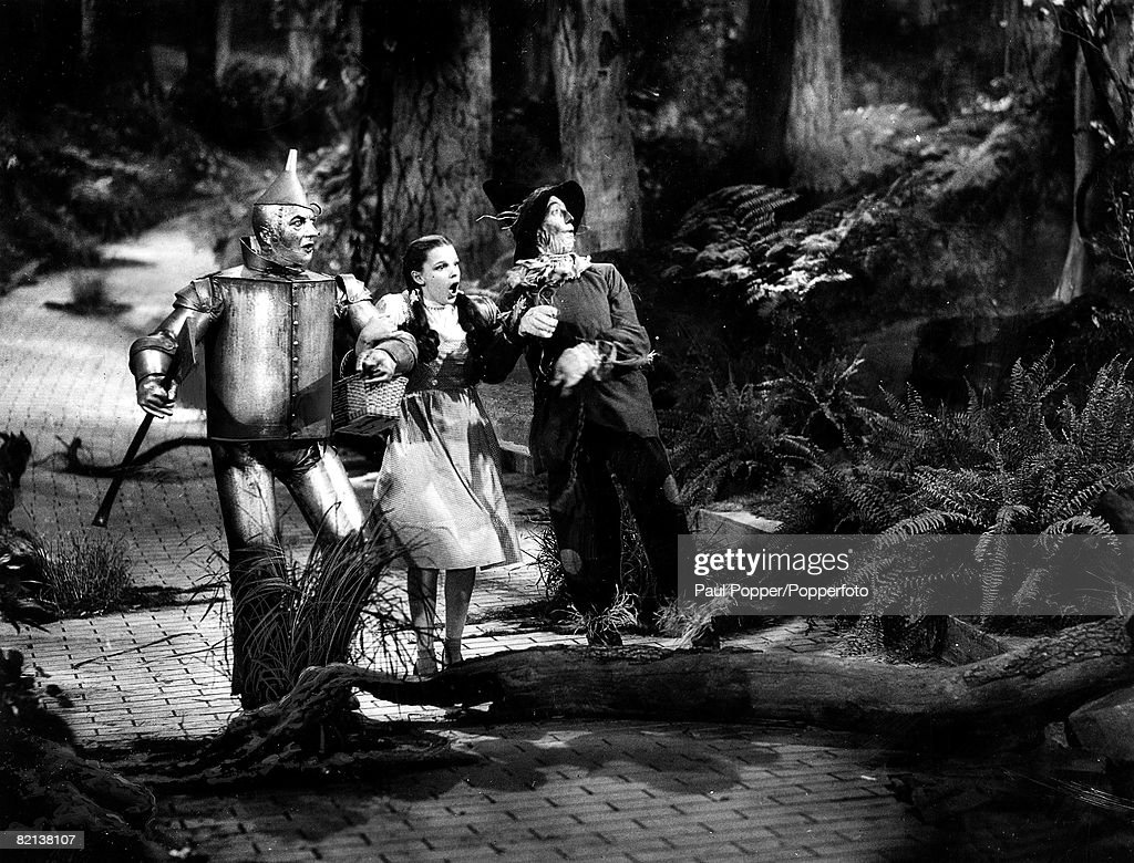 Volume 2 Page 100 Picture 23 A picture from the film 'The Wizard of Oz' showing American actress Judy Garland who played the role of Dorothy flanked...