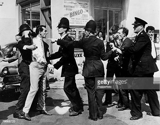 Volume 2 Page 120 Picture 4 Hastings Sussex England 3rd August Policemen try to calm down confrontations between youngsters after fighting broke out...