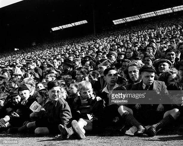 Volume 2 Page 17 Pic 10 Football Children at the front watching the Wolverhampton Wanderers match1949