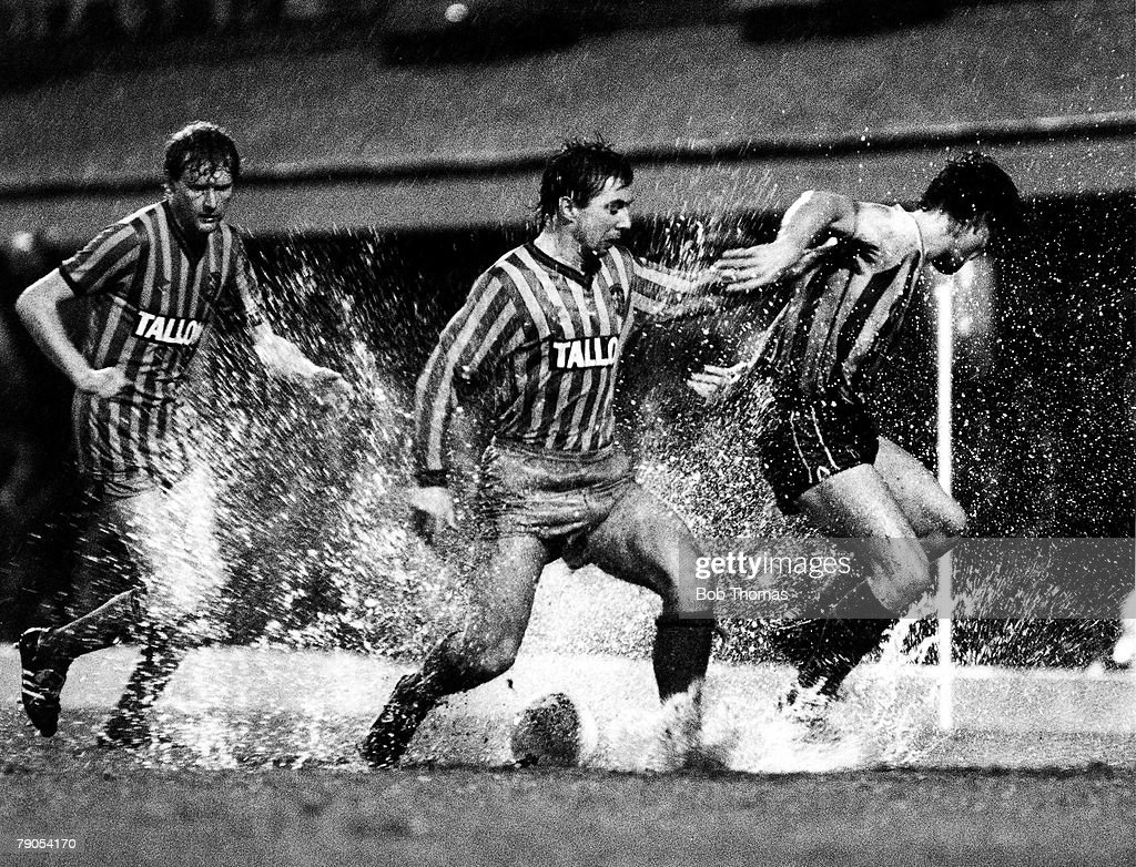 Volume 2, Page 19, Pic 3, Football, Highfield Road, Coventry, England, 2nd January 1984, Division One, Coventry City 2 v Sunderland 1, Coventry City defender Steve Jacobs clashes with Sunderland+s Paul Bracewell as Coventry+s Ashley Grimes looks on, The match was played in torrential rain throughout and the pitch was clearly waterlogged