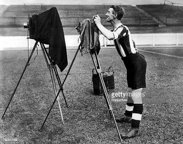 Volume 2 Page 19 Pic 4 Football A Notts County player prepares to take a photograph of his teammates during a photocall using some old camera...