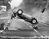 Volume 2 Page 4 picture 4 Sport Motor Racing German Grand Prix Berlin 1959 Hans Hermann crashes his car and flips in mid air He was uninjured in the...