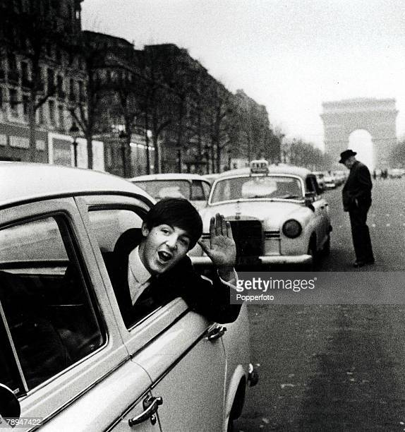 Volume 2 Page 84 Picture 2 The Beatles January 1964 Paul McCartney waves from a taxi on the Champs Elysees Paris France