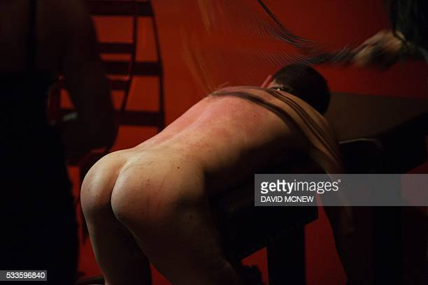 A voluntary submissive man is whipped at a dungeon party during the DomCon LA domination convention on May 21 2016 in Los Angeles California The...