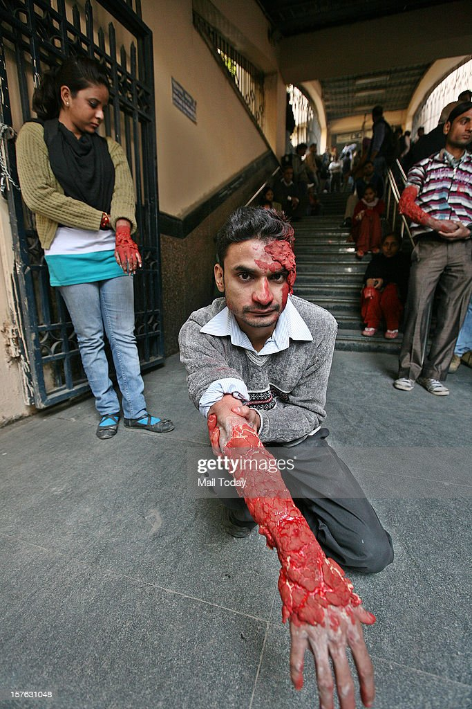 Volunteer acting as a bomb blast victim waits for rescue operation during a mock security drill as part of Delhi Emergency Management Exercise (DEMEX) in New Delhi on Tuesday.
