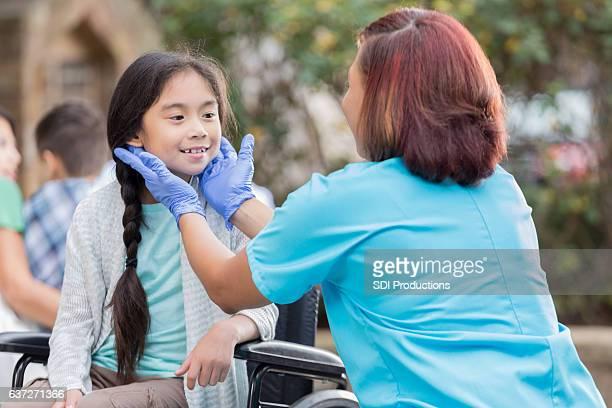 Volunteer African American doctor volunteers at outdoor free clinic