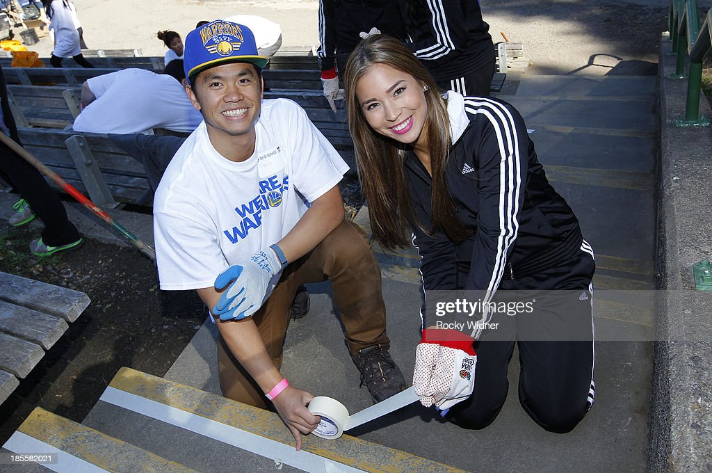 A volunteer and a Warrior Girl do their part to clean up McLaren park during Warriors Day Of Service as part of NBA Cares Week Of Service on October 21, 2013 in San Francisco, California.