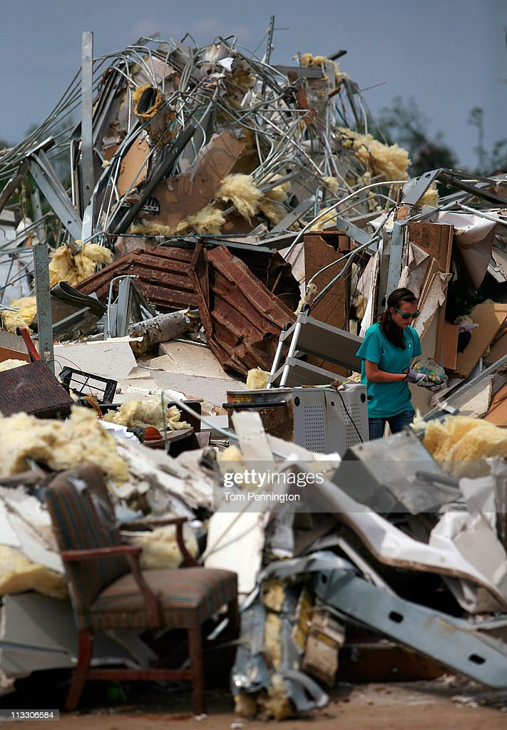 Volunteer Anna Porter combs through the rubble of Alberta Elementary School on May 1, 2011 in Tuscaloosa, Alabama. Alabama, the hardest-hit of six states, is reported to have been battered with at least an EF-4 rated tornado with the death toll across the South rising to over 300 as a result of the storms.