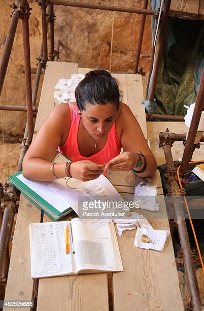 Volunteer archeologists work in the Arago cave near the village of Tautavel on July 28 2015 in Tautavel France Tautavel is one of the world's most...
