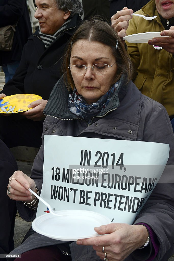 A volunteer attends a rally gathering members of food aid associations such as Banques Alimentaires, Croix-Rouge, Restos du Coeur and Secours Populaire, on February 4, 2013 in Avignon, south of France, as part of a nation wide day asking for more European subventions.