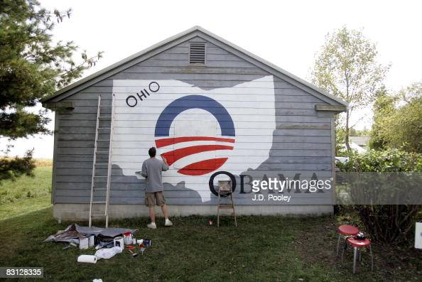 Volunteer Brian Heath paints an Obama campaign logo on the side of Gary Lahman's garage October 4 in support of US Democratic presidential candidate...