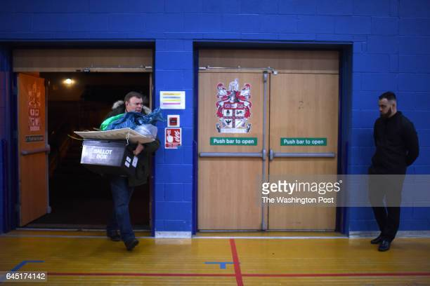 A volunteer carries a ballot box into the counting area after a byelection in Stoke on Trent United Kingdom on February 23 2016 The populist right...