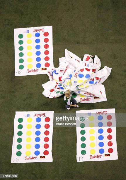 A volunteer cleans the field after a failed attempt to break the World Twister record for largest game of 4160 people at the Rogers Centre November 9...