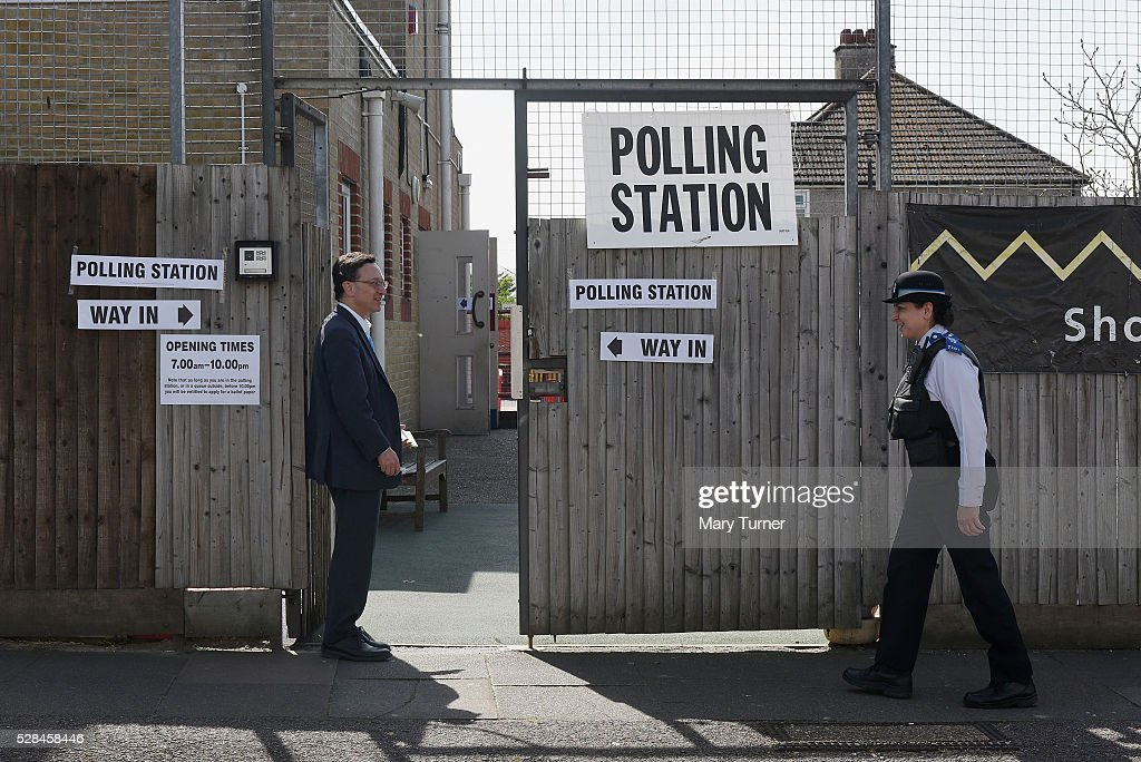 Volunteer Conservative Party teller Mark King talks to a local PCSO outside the polling station at Menorah Primary School, in Golders Green, North London where local people are registering their votes in the Mayoral and Assembly elections on May 5, 2016 in Barnet, United Kingdom. Today, dubbed 'Super Thursday',sees the British public vote in countrywide elections to choose members for the Scottish Parliament, the Welsh Assembly, the Northern Ireland Assembly, Local Councils, a new London Mayor and Police and Crime Commissioners. There are around 45 million registered voters in the UK and polling stations open from 7am until 10pm.