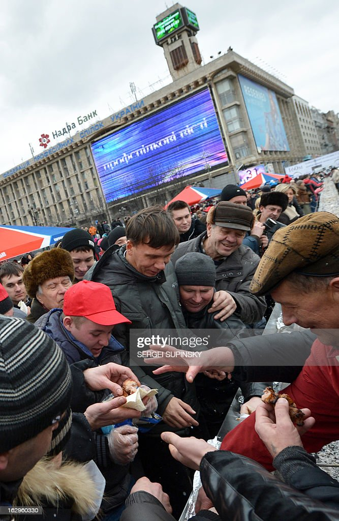 A volunteer cook hands out pieces of the world's longest shashlyk, or skewer of meat, measuring 150.6 meters in length in the Ukrainian capital of Kiev to set a new world record on March 2, 2013. Officials of the Ukrainian National Register of Records fixed the new record for the longest shashlyk, a popular food item throughout the former Soviet Union, Eastern Europe, India, Iran, Mongolia, Morocco, Pakistan and Israel among other places.