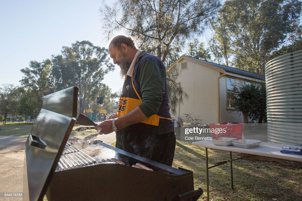 A volunteer cooks a sausage sizzle at Kingswood Park Public School in the electorate of in the key seat of Lindsay on July 2, 2016 on July 2, 2016 in Penrith, Australia. Voters head to the polls today to elect the 45th parliament of Australia.