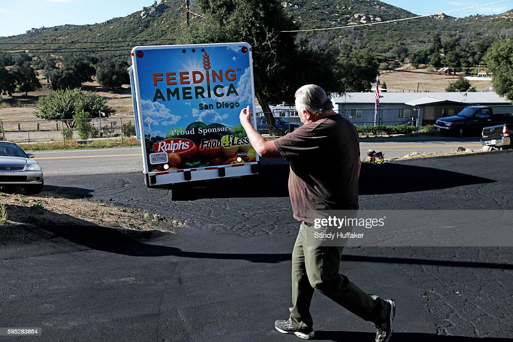 Volunteer Dave Klaus helps guide a Feeding America truck into the parking lot on Thursday November 3 2011 at the Descanso Town Hall in Descanso...