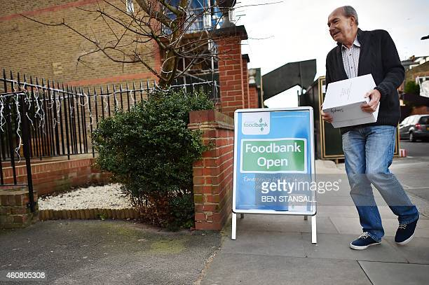 A volunteer delivers a food donation to a foodbank charity in west London on December 23 2014 Food bank use in Britain is growing rapidly and...