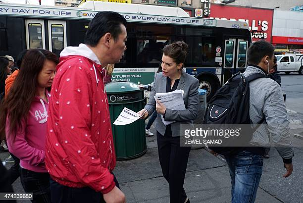 A volunteer distributes flyers in multiple languages about health concerns labor practices regulations and wages at nail salons to commuters outside...