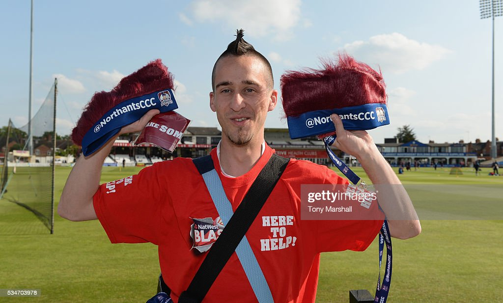 A volunteer distributes Northamptonshire CCC hats during the NatWest T20 Blast match between Northamptonshire and Derbyshire at The County Ground on May 27, 2016 in Northampton, England.